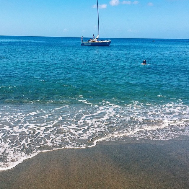 Black sand beach in paradise. #regram @nylonhk #luxury #travel #ocean #beach #sailboat #waves #stlucia #pitons #ansechastanet