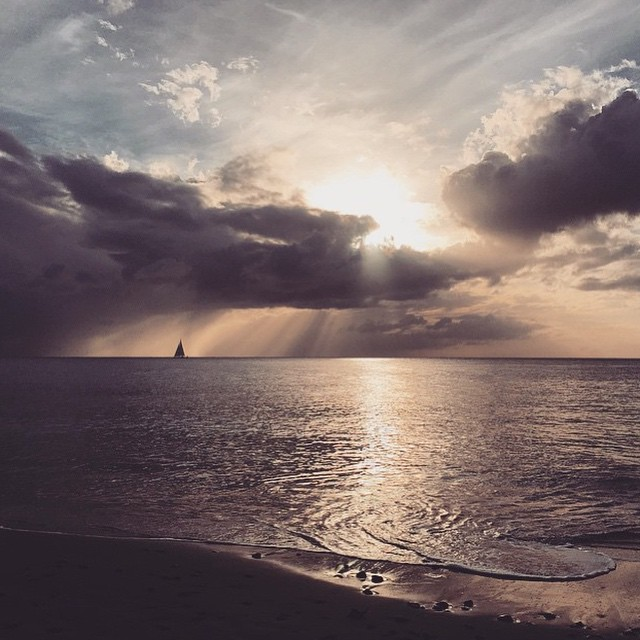 The last bit of sunshine shining through the clouds over St. Lucia. #ansechastanet #luxury #travel #heavenonearth #paradise #beach #ocean #waves #clouds #sunset #regram @stephaniebrauer